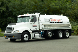 how to clean septic tank without pumping